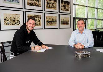 Goalkeeper Roman Bürki and Borussia Dortmund's Sporting Director Michael Zorc. (Photo courtesy: Borussia Dortmund)