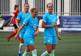 VfL Wolfsburg's Lara Dickenmann (center) celebrating a goal with her teammates Lena Goessling (right) and Joelle Wedemeyer (left). (© CPD Football)