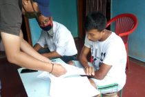 Khangembam Bidyasagar Singh signing his contract with TRAU FC. (Photo courtesy: TRAU FC)