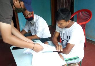 Khangembam Bidyasagar Singh signing his contract with TRAU FC. (Photo courtesy: TRAU FC)