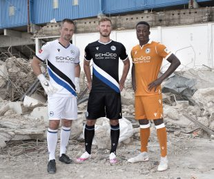 The DSC Arminia Bielefeld kits for the 2020-21 Bundesliga season - left to right: Former club goalkeeper Dennis Eilhoff in the away kit, captain Fabian Klos in the home kit and U-19 player Kenson Bauer in the third kit. (Photo © www.sport-vision-pro.de / DSC Arminia Bielefeld)