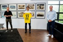 Borussia Dortmund's Chairman of the Board Hans-Joachim Watzke, midfielder Jude Bellingham and Sporting Director Michael Zorc. (Photo © Borussia Dortmund)