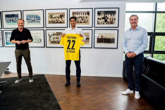 Borussia Dortmund's Chairman of the Board Hans-Joachim Watzke, midfielder Jude Bellingham and Sporting Director Michael Zorc. (Photo © Borussia Dortmund)