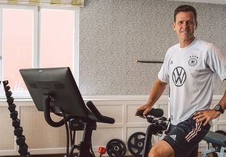 Oliver Bierhoff, Director of National Football & Academy, with a 'Peloton Bike'. (Photo courtesy: Philipp Reinhard / DFB)