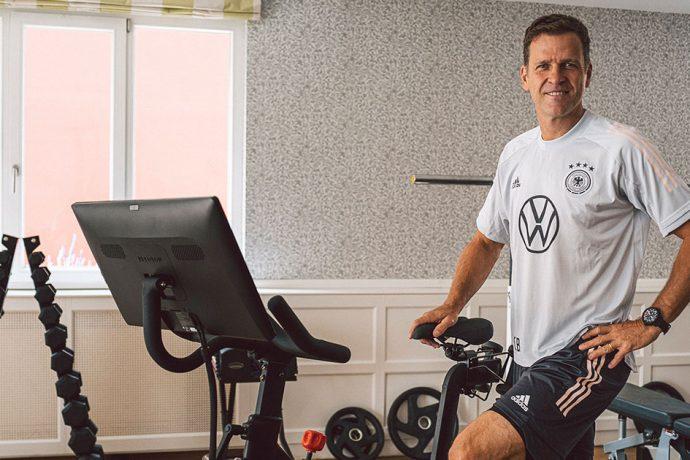Oliver Bierhoff, Director of National Football & Academy, with a 'Peloton Bike'. (Photo courtesy: Philipp Reinhard / DFB)