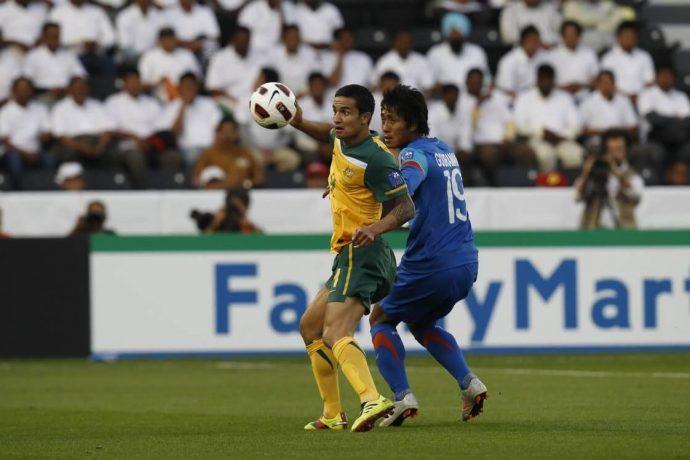 Indian national team defender Gouramangi Moirangthem Singh in action against Australia's Tim Cahill in an AFC Asian Cup Qatae 2011 match. (Photo courtesy: AIFF Media)