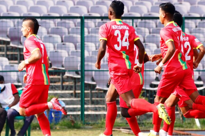 Tajikistan international Komron Tursunov and his TRAU FC teammates celebrate a goal in the Hero I-League. (Photo courtesy: AIFF Media)