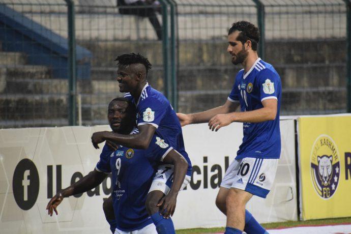Dipanda Dicka celebrates a Hero I-League goal with his Real Kashmir FC teammates. (Photo courtesy: AIFF Media)