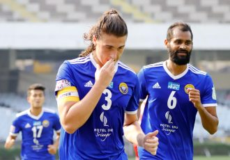 Mason Robertson and his Real Kashmir FC teammates celebrate a goal in the Hero I-League. (Photo courtesy: AIFF Media)