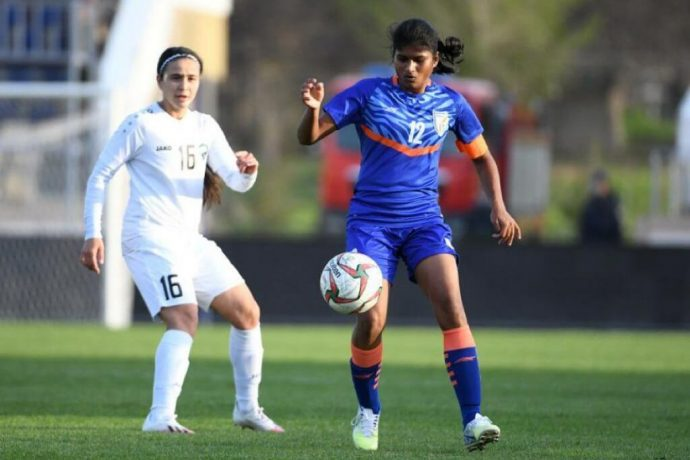 Indian women's national team captain Indumathi Kathiresan and Uzbekistan's Ezoza Sharipova. (Photo courtesy: AIFF Media)