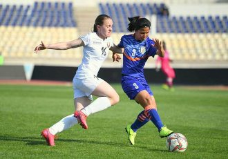 Indian women's national team defender Wangkhem Linthoingambi Devi faces a tackle by Belarus player Surautsava Melana. (Photo courtesy: AIFF Media)