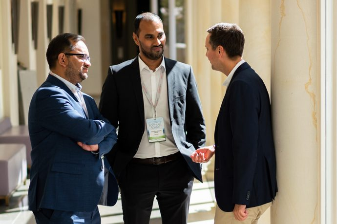 Chris Punnakkattu Daniel (center) and Arunava Chaudhuri (left) at the International Frankfurt Football Summit. (Photo courtesy: © ZEIT)