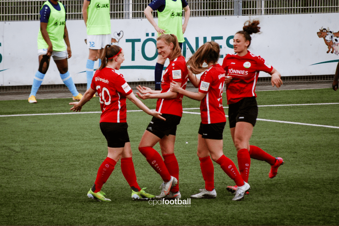 FSV Gütersloh 2009 players celebrate a goal against Borussia Bocholt in a 2nd Division Women's Bundesliga game. (©CPD Football)