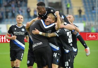 DSC Arminia Bielefeld players celebrate a goal in the Bundesliga and a strong partnership between their club and the Melitta Group. (Photo courtesy: Melitta Group Management GmbH & Co. KG)