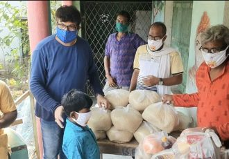 General Secretary Joydeep Mukherjee and the Indian Football Association (IFA) provide essential food rations to those affected by the Yaas Cyclone in the Sunderbans, West Bengal. (Photo courtesy: AIFF Media)